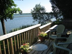 Private pet-friendly waterfront cottage with firepit and paddleboat near Sandbanks