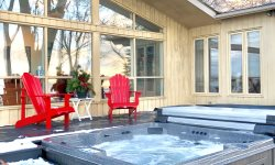 Waterfront designer home with hot tub on West Lake