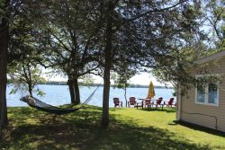 Pet-friendly Waterfront Cottage with firepit and dock in Prince Edward County