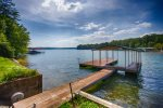 Private dock w/ single boat slip and ladder for swimming