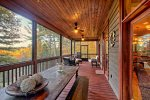 Expansive screened in porch off of entry level family room