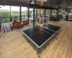 Ping pong table on screened entertainment area