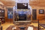 stone fireplace in entry level family room
