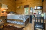 Inside of tree house, queen bed and twin trundle pull out