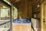 4 person hot tub on screened in porch