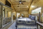 Upper Level Master suite w/ Barn door opening to enjoy the view
