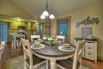 Open floorplan with kitchen, dining, and family room