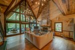 Floor to ceiling glass overlooking the Toccoa River