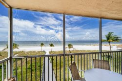 Beach Villas #201 | Fantastic Island Location with Beach View! Heated Pool & BBQ Grilling Area!