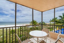 Beach Villas #206 | Best View of Beach, Gulf, and Bay! Screened Lanai & Heated Pool! Located Close to Times Square