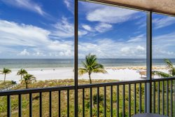 Beach Villas #303 | Bright & Airy! Tropical Beachfront Condo in Prime North Island Location!