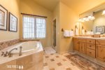 Main Floor: Master Bedroom En Suite with Soaking Tub