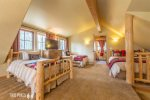 Upper Loft: Sleeping Area with 2 Twin Beds Sleeps 2 & Queen Bed Sleeps 2