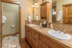 Main Floor Guest En Suite with double vanity and walk-in shower