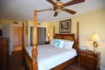 Master bedroom with ceiling fan and ensuite bathroom