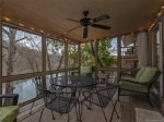 Enjoy Family time on the screened in porch while catching the beautiful view