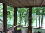 Screened in private patio with a view of the lake