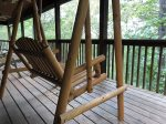 Wooden swing on the deck