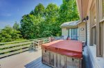 Exterior view of back deck featuring a hot tub