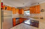 Fully updated kitchen with granite counter top and stainless steel appliances