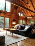 Spacious living area with cathedral ceiling brings the outdoors indoors for your enjoyment