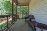Screened Porch with Beautiful Wicker Furniture