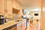Recently remodeled kitchen with new appliances, gas range, and granite counters