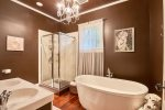 Bathroom with soaking tub and standup shower