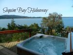 Hot tub! Stunning Waterfront and Mountain Views from this house