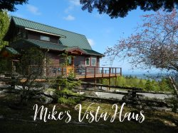 Immaculate Cedar home with panoramic water views of the Strait of Juan de Fuca and Sequim Bay