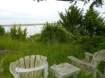 Seating at edge of bluff overlooking water and Dungeness Spit