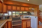 Fully equipped kitchen with 2 ovens, water and mountain view