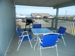 Side deck with outdoor seating and BBQ, water view, mountain view