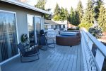 Full deck with water views, seating, grill and Hot Tub