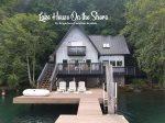 Custom cottage perched on Lake Sutherland, boat dock, decks