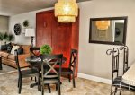 Murphy bed against the wall & dining table