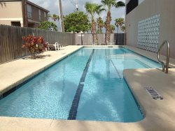 Vacation rental condominium. 1 Bedroom , Sleeps 4, ( king, 2 single sleeper sofas ), 1 bathroom. No pets allowed. Half block to bay, close to entertainment district,  Shared Pool , CITY PERMIT # 2015-4013763