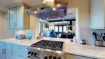 Stove top and oven with view into dining and living room