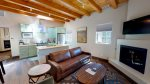 Beautiful natural wood ceiling beams embellish the rich leathers and cactus colored cabinetry