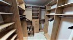Master closet with plenty of shelf and hanging space