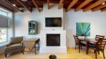 Gas fireplace and large smart tv create a comfortable space
