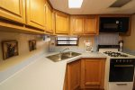 Fully furnished kitchen with plenty of prep and cooking space