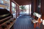 beautiful and spacious deck with grill, backing up to the Blue River