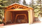 Picnic Shelter on RV Site with Bench Swing and Full Hookups