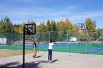 Enjoy a game of tennis or basketball with friends