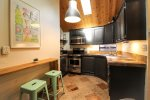 Enjoy coffee while making breakfast in this adorable kitchen