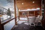 Enjoy a cup of coffee or a glass of wine come rain or shine... or snow on this covered patio