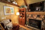 Cuddle Up in this Sweet Space & Enjoy Cable Telivision by the Fire