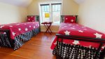 Very spacious master bedroom upstairs with a queen bed