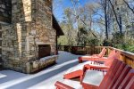 Outdoor fireplace and deck in winter